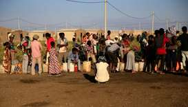 Ethiopian refugees fleeing from the ongoing fighting in Tigray region, queue for water, at the Fasha