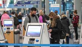 Travelers at O'Hare International Airport ahead of the Thanksgiving holiday in Chicago