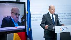 German Finance Minister and Vice-Chancellor Olaf Scholz (R) and German Economy Minister Peter Altmai