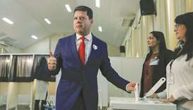 Fabian Picardo, Gibraltar's chief minister poses for photographers as he casts his ballot at a polli