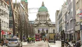 Police officers patrol the streets in Belfast yesterday, as stricter restrictions come in to force t