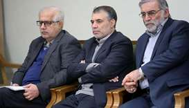 Prominent Iranian scientist Mohsen Fakhrizadeh (extreme right)  is seen in Iran, in this undated pho