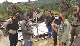 This handout photo taken and released yesterday by the Central Sulawesi Province Police shows police