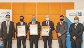 Officials with the ISO certificates.
