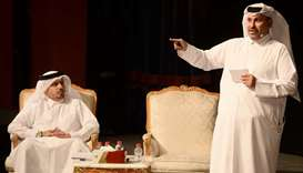 Dr al-Hamidi (right) presenting his lecture. With him is *Arrayah editor-in-chief al-Mohannadi. PICT