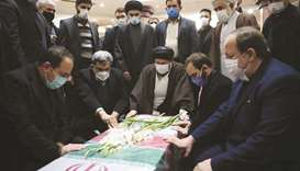 Mourners gather around the coffin of Iranian nuclear scientist Mohsen Fakhrizadeh at the Imam Khomei