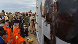 Buddhist monks perform a ceremony to bless the crate containing Kaavan the Asian elephant upon his a