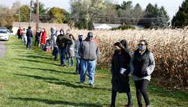 Voters wait in line to cast their ballots on Election Day near Dryland United Church of Christ in Lo