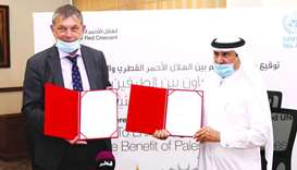 Philippe Lazzarini and Ali bin Hassan al-Hammadi at the MoU signing Tuesday.