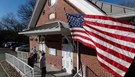US Election Day unfolds smoothly, so far defying fears of disruption