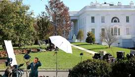Journalists wait for news after early results in the Presidential election at the White House in Was