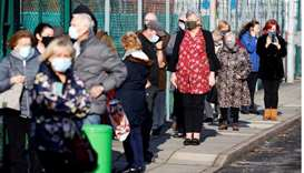 People queue at a coronavirus disease testing centre in Liverpool, Britain