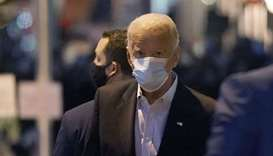 Democratic presidential nominee Joe Biden walks out of The Queen theater in Wilmington, Delaware.