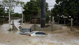 Submerged cars are pictured at an area affected by floods after the passage of Storm Eta, in El Prog