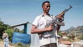 An Ethiopia's Amhara Region militia man poses in the town of Musebamb, 44 kms northwest from Gondar,