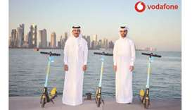 Vodafone Qatar Business Services director Mahday Saad al-Hebabi and Loop CEO Mohamed al-Mohannadi wi
