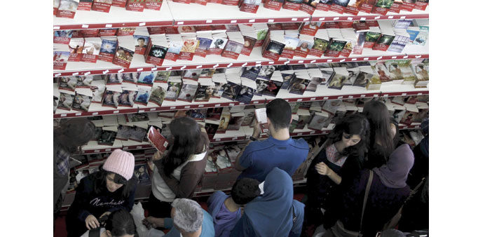 People look at books during the 20th International Book Fair in Algiers.