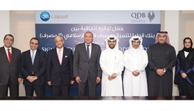 QIB and QDB officials after signing the agreement. Al Dhameen has contributed to an ever-evolving Qa