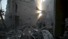Residents inspect damage in a site hit by what activists said were airstrikes carried out by the Rus