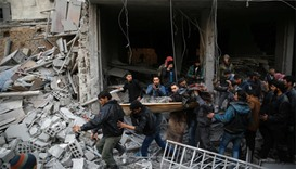 Syrians and civil defence workers evacuate victims following air strikes