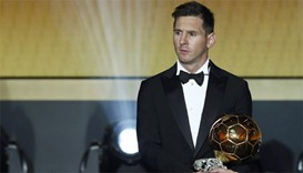 FC Barcelona's Lionel Messi of Argentina holds the World Player of the Year award during the FIFA Ba