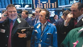 Traders work on the floor of the New York Stock Exchange. The S&P 500 dropped 0.9% to close the year
