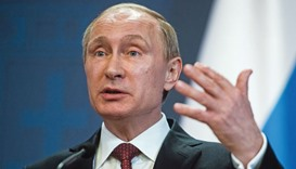 Russia's President Vladimir Putin gestures whilst speaking during a news conference in Budapest (fil