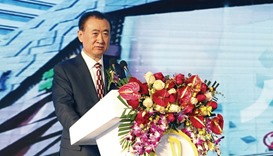 Wang Jianlin, chairman of Dalian Wanda Group, speaks during a signing ceremony with US film studio L