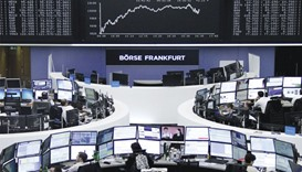 Traders work at the Frankfurt Stock Exchange. The bourse yesterday rose 1.6%.