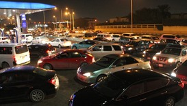 Long queue outside a fuel station in Doha