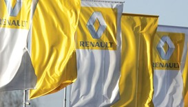 The logo of French car manufacturer Renault is seen on flags in front of a dealership in Strasbourg,