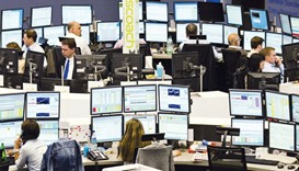 Brokers work at the Frankfurt Stock Exchange. Frankfurt was the worst hit among Europe's largest exc