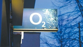 The O2 logo is seen on a illuminated sign outside a mobile phone store operated by Telefonica Deutsc
