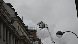 Firefighters work on extinguishing a fire at the Ritz Hotel in Paris