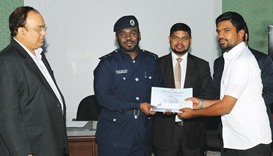 An MoI official giving a certificate to a participant.