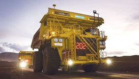 Autonomous haulage trucks operate at a mine in the Pilbara area of Western Australia.