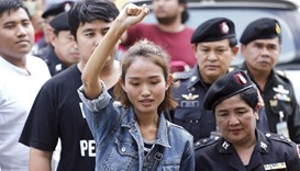 Student activist Chonthicha Jangrew arrives at the Thai military court in Bangkok yesterday.