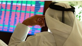 Qatar shares edge lower, but stay above 9,500 mark