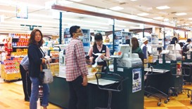 Shoppers at a supermarket in Tokyo. Doubts over the efficacy of Japan Prime Minister Shinzo Abe's co
