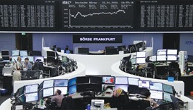 Traders work at the Frankfurt Stock Exchange yesterday. The DAX 30 was up 2.0% at 9,764.88 points at