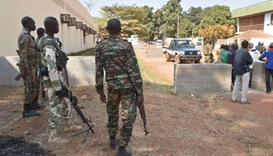 Central African Republic gendarmes and police officers stand guard outside a vote-counting centre fo