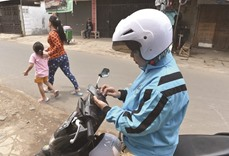 Indonesia's Muslim women hail exclusive motorbike taxis