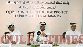 Al-Khalifa and other officials explain QDB's Franchise Project to reporters. PICTURE: Othman al-Sama