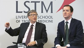 Microsoft co-founder Bill Gates (L) speaks as he sits with Britain's Chancellor George Osborne