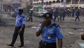 Police at the scene of  the suicide attack