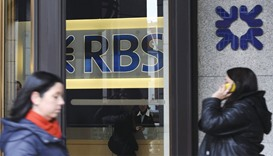Pedestrians walk past an RBS branch in London. Chief executive Ross McEwan has been trying to clean
