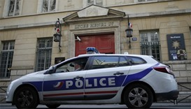 A French police car is seen outside the Lycee Henri IV after police intervened at Paris high schools