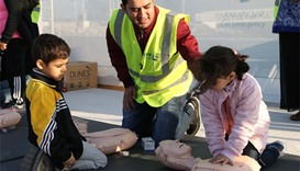 A child undergoes CPR training