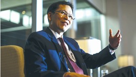 Thailand's central bank governor Veerathai Santiprabhob gestures during an interview with Reuters in