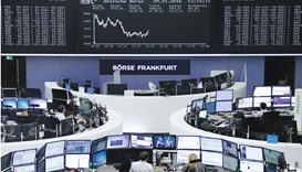 Traders work at the stock exchange in Frankfurt. The DAX 30 was up 1.6% at 9,798.11 points at close